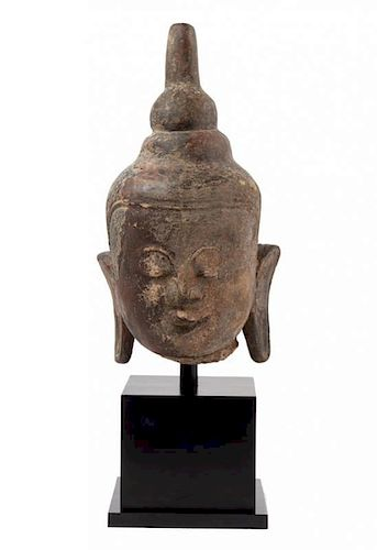 A Thai Stone Head of Buddha Height overall 26 1/2 inches.
