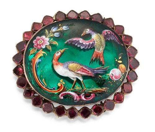 A 19TH CENTURY POLYCHROME ENAMEL AND GARNET CLASP, the oval