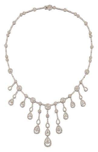 A DIAMOND-SET FRINGE NECKLACE  Of bib design, issuing a gra