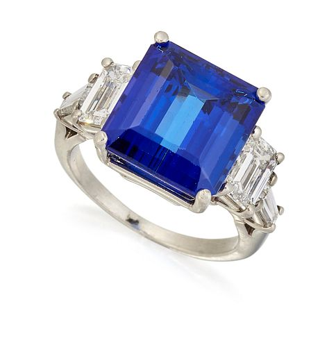 A TANZANITE AND DIAMOND RING, the step cut tanzanite, estim