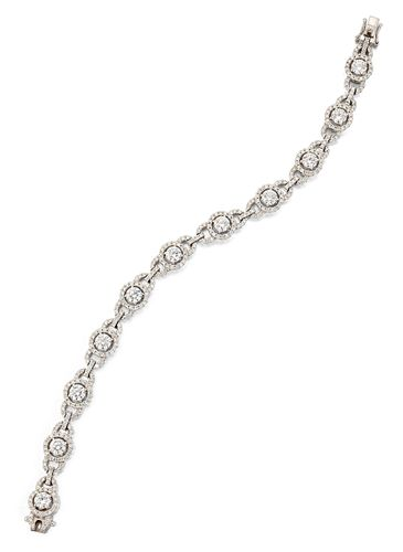 A MULTIPLE GIA CERTIFIED PLATINUM DIAMOND HALO BRACELET,?th