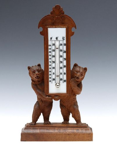 BLACK FOREST CARVING OF BEARS PRESENTING A THERMOMETER