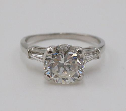 Modern Round Brilliant Diamond and Platinum Ring