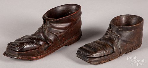 Two carved shoe-form match holders