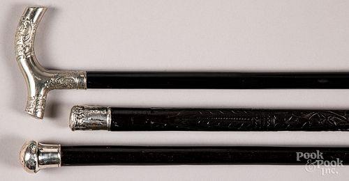 Three ebonized canes