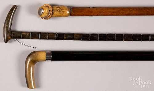 Three horn and antler grip canes.