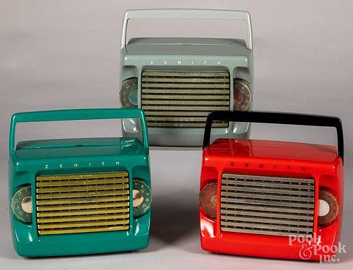 Three Zenith model M403 plastic portable radios