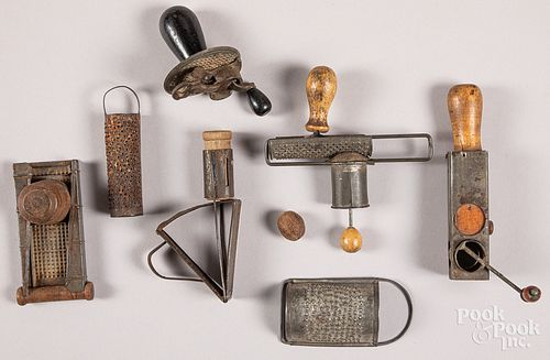 Collection of seven tin nutmeg graters, 19th c.
