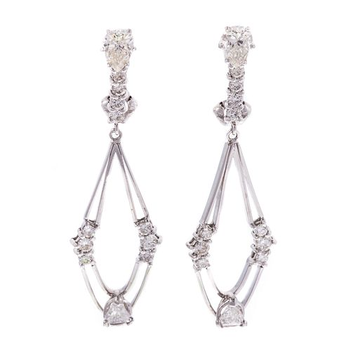 A Pair of Modern Diamond Dangle Earrings in 14K