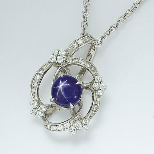 A STAR SAPPHIRE WITH DIAMOND PENDANT NECKLACE