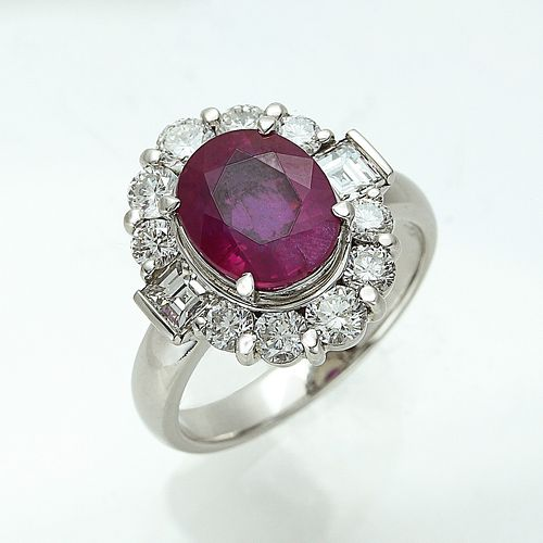 A RUBY WITH DIAMOND RING