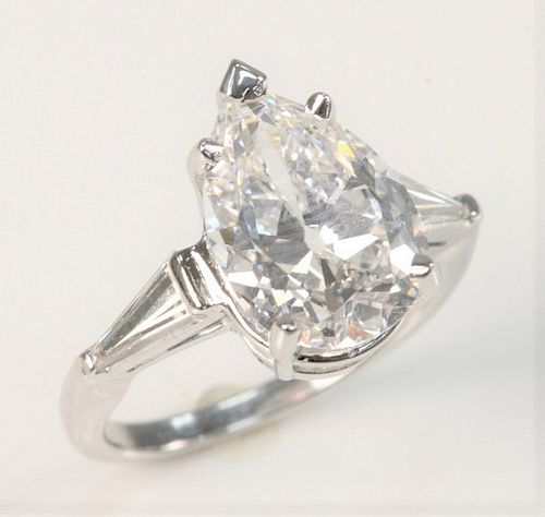 Platinum and Diamond Ring  Set with 5.5 Carat Pear Shaped Diamond,  E color, VS1,  G.I.A. report #2215245457, measuring 14.17 x 9.99 x 6.05 millime