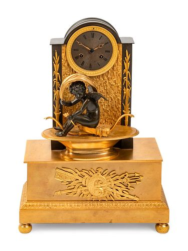 A Louis Philippe Gilt and Patinated Bronze Mantel Clock