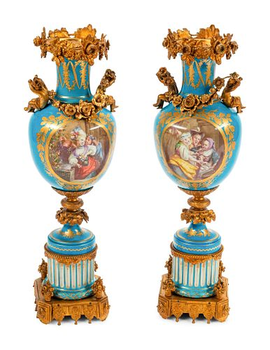 A Pair of Sevres Style Gilt Bronze Mounted Porcelain Urns