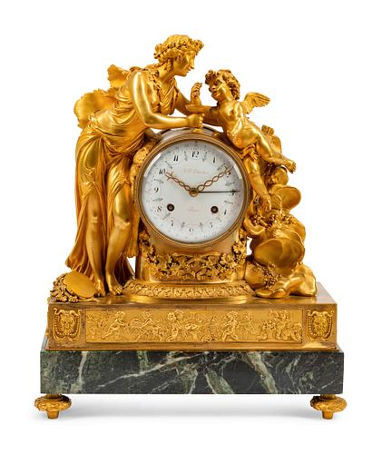 A French Gilt Bronze and Marble Mantel Clock