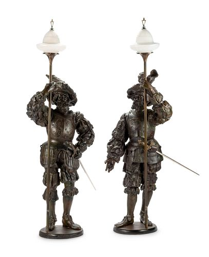 A Pair of Cast Metal Figural Torcheres