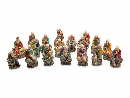 A Set of Eighteen Chinese Export Enameled Porcelain Figures of Immortals