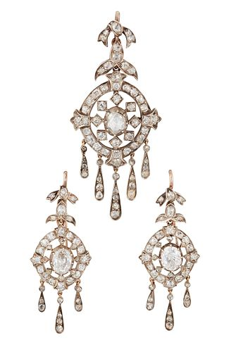 A DIAMOND PENDANT AND EARRING SUITE, the pendant with a cen
