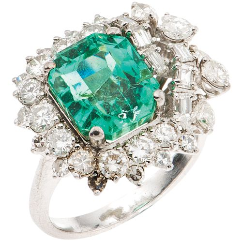 RING WITH EMERALD AND DIAMONDS IN PALLADIUM SILVER, Weight: 6.0 g, Size: 6 ¾, 1 Emerald octagonal faceted cut (chipped on the girdle)