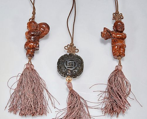 Group of Three Chinese Wood Toggles
