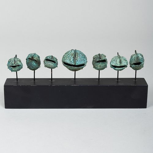Group of Seven Mixtec Copper and Wire Cephalomorphic Bells