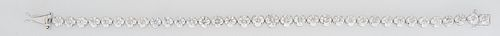 Lady's Platinum Tennis Bracelet, each of the 35 links with graduated round diamonds, total diamond weight- 11.44 cts., L.- 7 1/4 in., with appraisal.