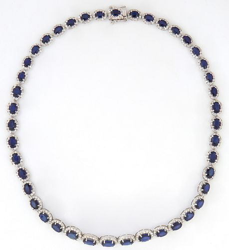 14K White Gold Link Necklace, each of the 42 links with an oval blue sapphire atop a border of tiny round diamonds, total sapphire weight- 35.31 cts.,