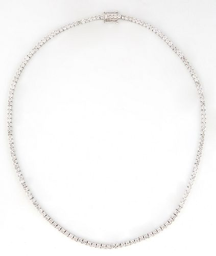 14K White Gold Tennis Necklace, each of the 156 links with a graduated round diamond, total diamond weight- 15.16 cts., L.- 17 in., with appraisal.