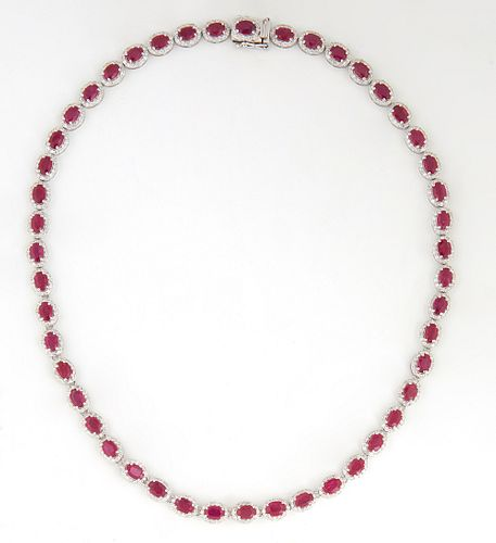 Lady's Platinum Link Necklace, each of the 47 links with an oval ruby atop of border of tiny round diamonds, total ruby weight- 22.91 cts., total diam