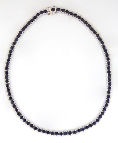 14K White Gold Link Necklace, each of the 82 links with an oval faceted blue sapphire bordered on two sides by tiny white diamonds, total sapphire wei