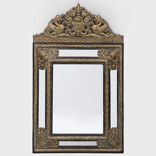 Dutch Baroque Style Brass Repoussé and Ebonized Mirror