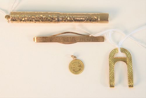 Four piece lot to include;  14 Karat Gold Fountain Pen length 3 5/8 inches, total weight 14.9 grams;  Cartier 18 Karat gold tie clip #336, 7 grams;  B