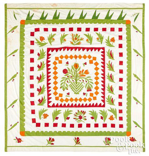 Floral appliqué quilt top