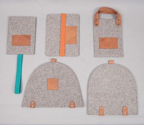 Lote de 5 guardas. Siglo XXI. Elaboradas en fieltro color gris con aplicaciones de piel. Consta de: bolsa, 2 guardas, otros.