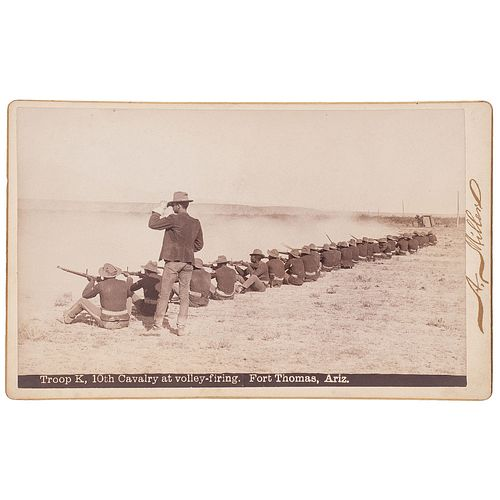[BUFFALO SOLDIERS]. MILLER, Andrew, photographer. Boudoir photograph of Lt. Powhatan H. Clarke and Troop K, 10th Cavalry at volley-firing. Fort Thomas