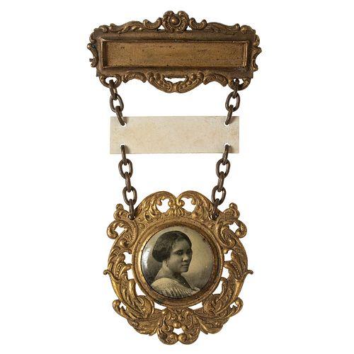 [BUSINESS] -- [WALKER, Madam C.J. (born Sarah Breedlove, 1867-1919)]. Madam C.J. Walker Company Sales Representative Badge. Rochester, NY: Bastian Bro