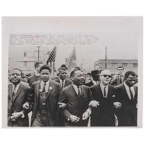 [KING, Martin Luther, Jr. (1929-1968)]. Press photograph of Martin Luther King locking arms with his aides while leading march to the Montgomery, AL c