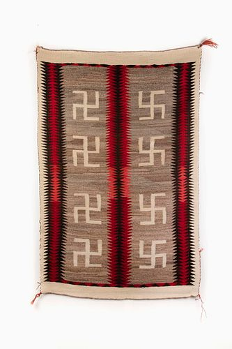 A Navajo Four Corners Whirling Log Saddle Blanket, ca. 1920