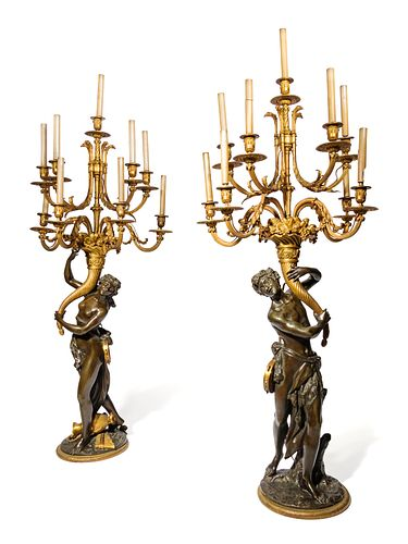 A Pair of Large Gilt and Patinated Bronze Figural Nine-Light Candelabra after the Models by Clodion