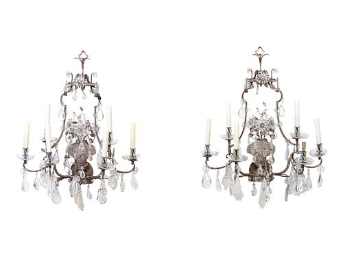A Pair of Maison Bagues Silvered Metal, Rock Crystal and Glass Six-Light Sconces