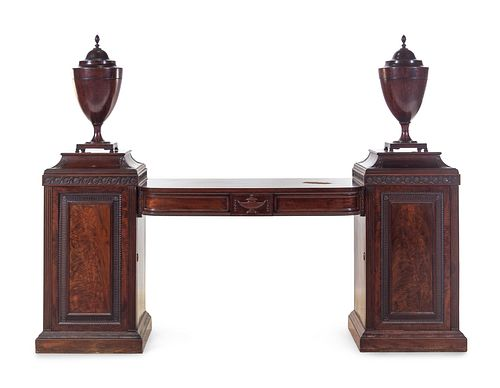 An Edwardian Carved and Figured Mahogany Double Pedestal Sideboard and a Pair of Urn-Form Cutlery Boxes