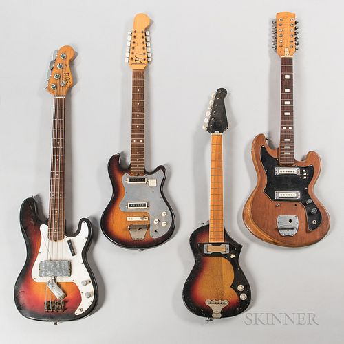 Electric Bass Guitar and Three Electric Guitars