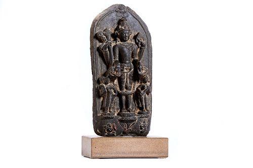 Schist stele depicting Vishnu with his two consorts Lakshmi and Saravastri, India Pala period, 11th - 12th century