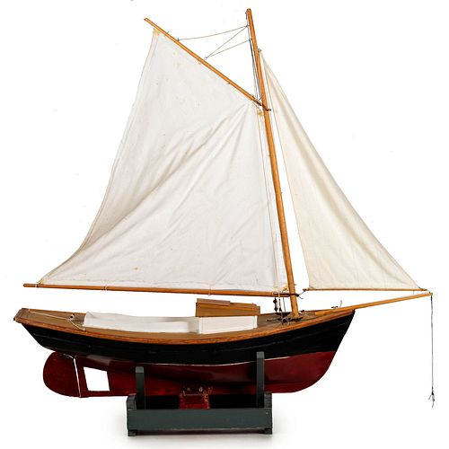 A Carved and Painted Wood Ship Model