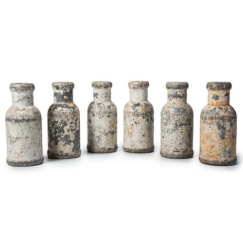 A Set of Six Painted and Weighted Metal Carnival Knock-over Bottles