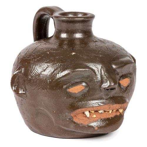 A Guy Daugherty Brown-Glaze Stoneware Face Jug, Bethune, South Carolina, Circa 1950