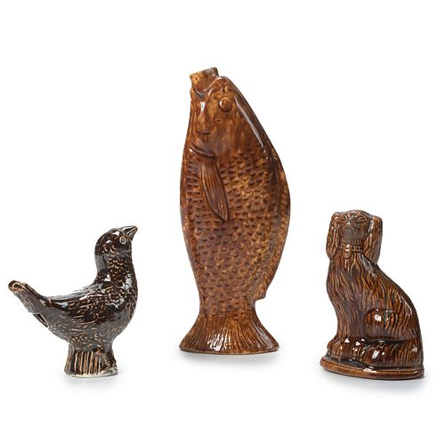 A Glazed Yellow Ware Spaniel Bank, Fish Flask, and Porcelain Bird-Form Whistle