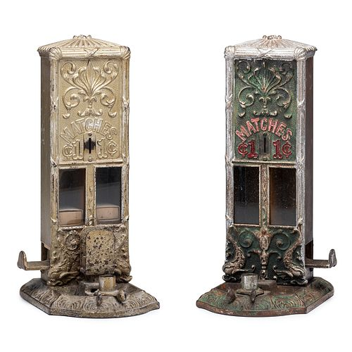 Two Northwestern Novelty Co. Cast Iron Penny Match Dispensers