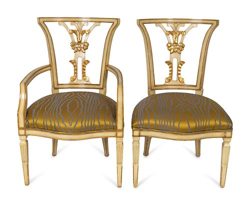 A Set of Ten Neoclassical Style Parcel-Gilt and Painted Dining Chairs Height 37 1/2 x depth 20 1/2, armchair width 25 and side chair width 24 inches.