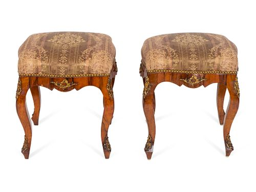 A Pair of Continental Rococo Style Gilt-Metal-Mounted Walnut Tabourets Height 21 1/2 x length 17 x depth 17 inches.